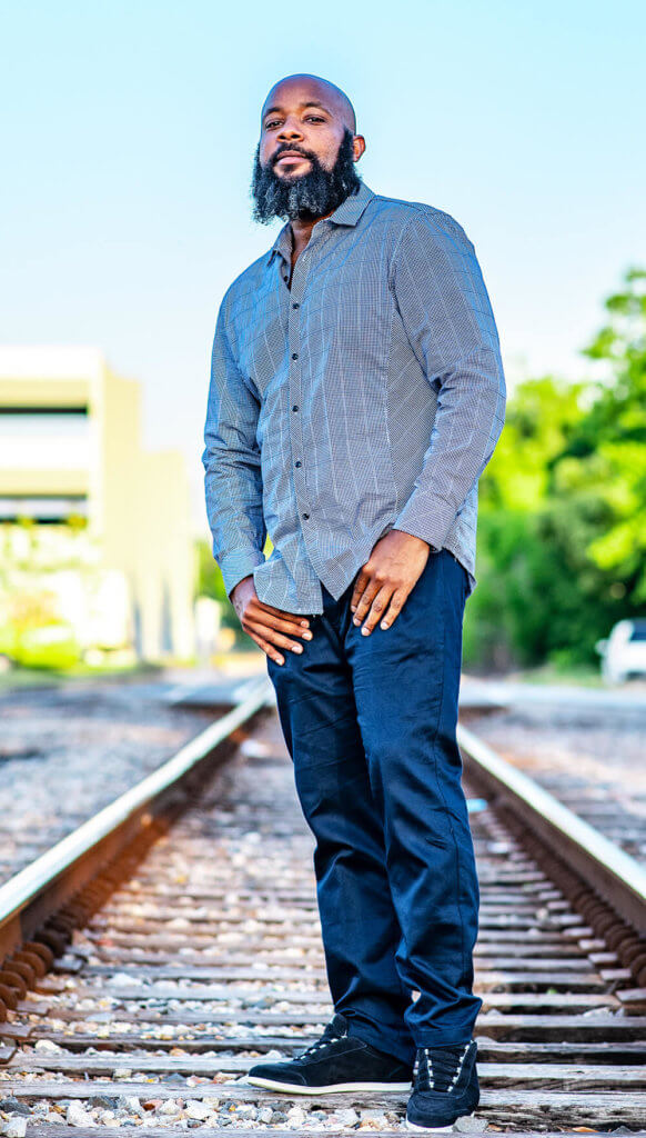 JClay standing on the train tracks