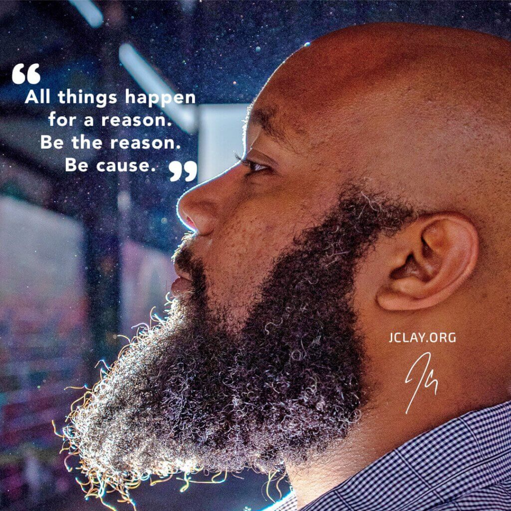 inspirational quote of jclay over an image of his bald head and beard