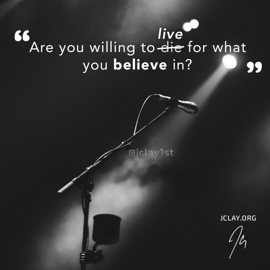 inspirational quote of jclay over an image of microphone in the limelight or spotlight