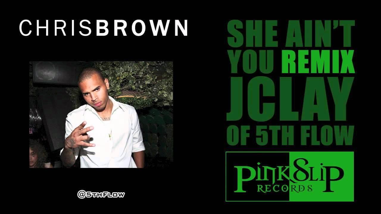Chris Brown throwing up the Epsilon Gamma Iota sign in white shirt