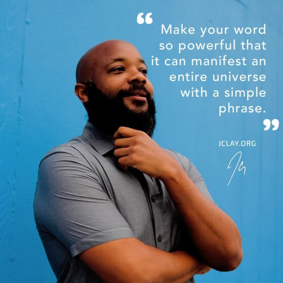 JClay holding beard in front of blue wall with inspirational quote