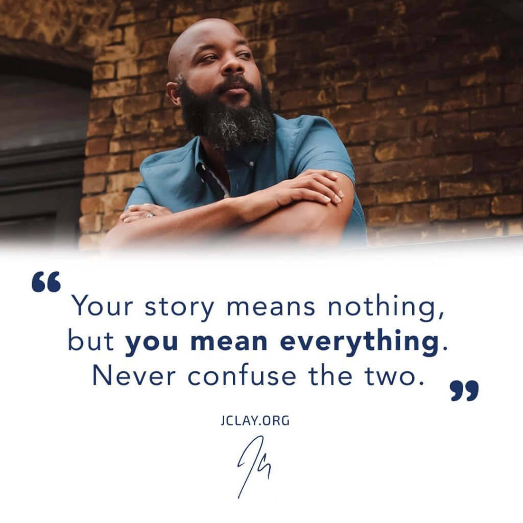 inspirational quote by jclay outside in blue shirt african american beard bald