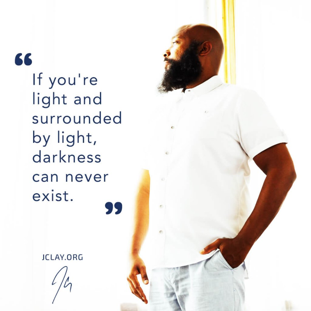 inspirational quote by jclay in white shirt about light