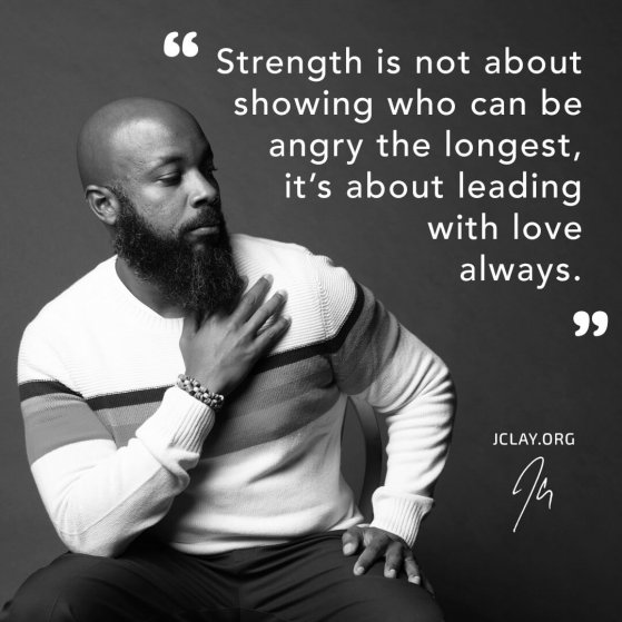 motivational quote by jclay about strength over image of him brushing off haters sitting on a stool