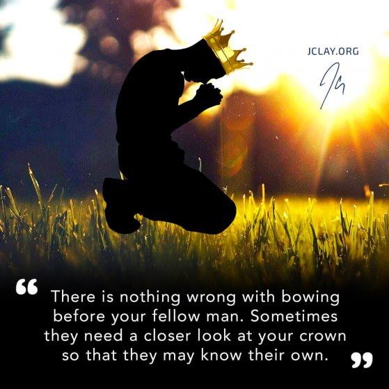dark man in crown kneeled on gras with motivational jclay quote