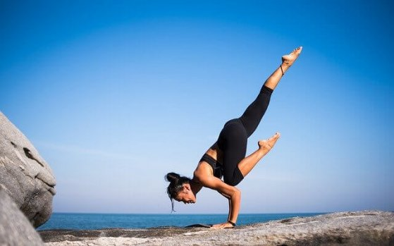 woman doing yoga on a mountain