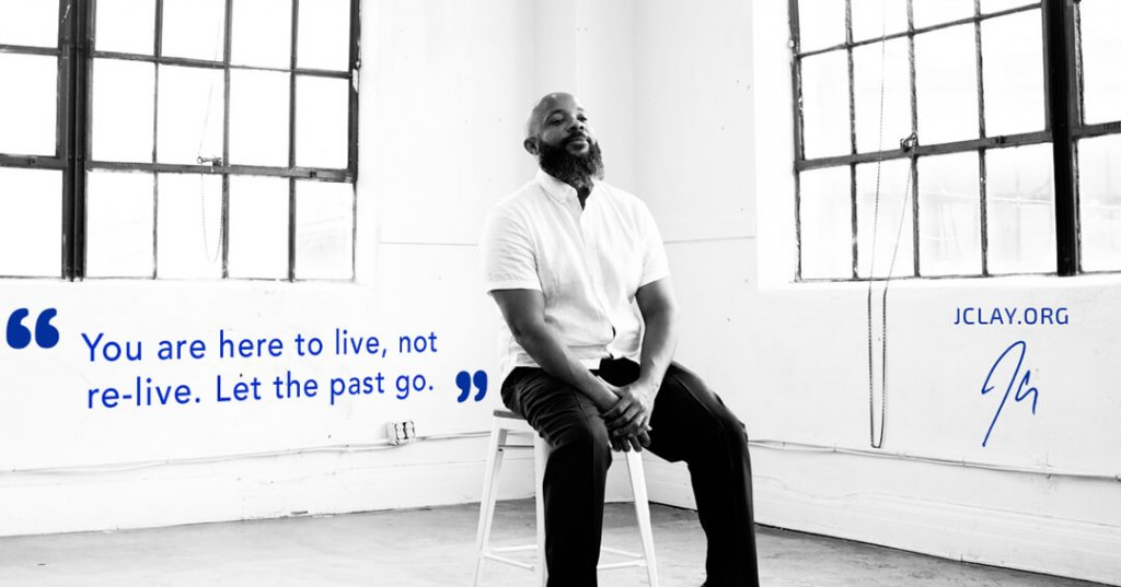 letting go life quote by jclay sitting on a stool in studio
