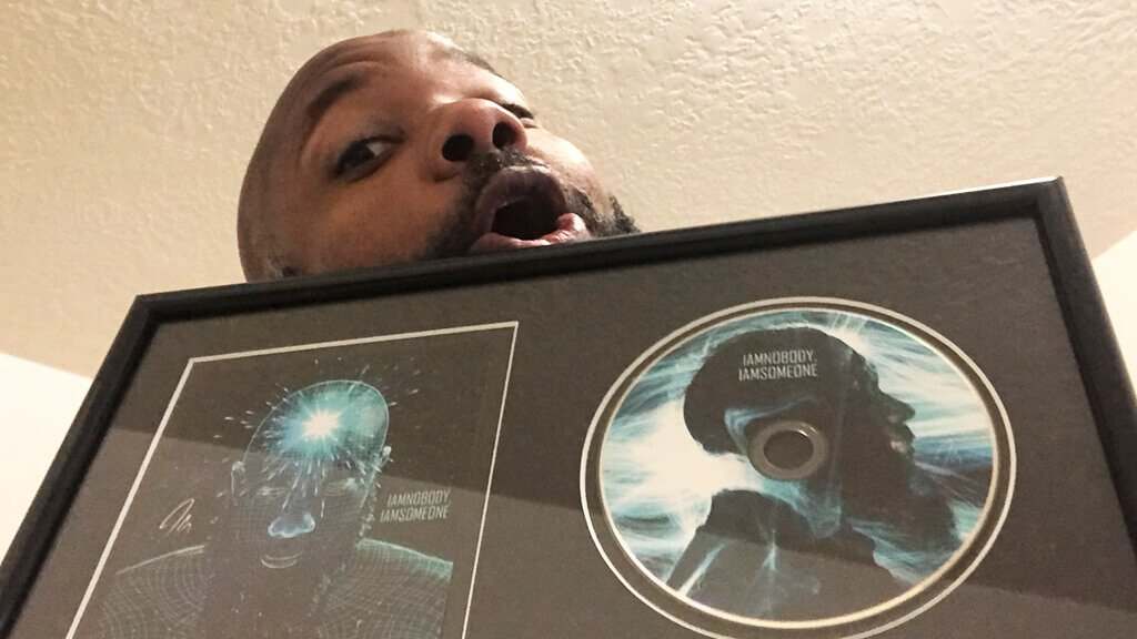 jclay holding album plaque for iamnobody iamsomeone